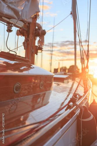 Fotobehang Schip Sunset on classic yachts in Sandhamn Sweden