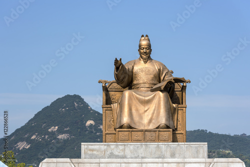 Statue of King Sejong at the  Gwanghwamun square in Seoul Poster