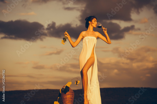 pretty woman with wine over sky