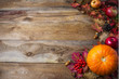Thanksgiving  or fall greeting background with pumpkins and fall