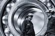 industry workers inside giant bearings, steel industry