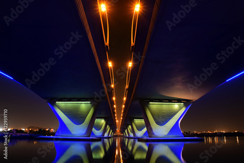 Staande foto Dubai Garhoud Bridge from base at night with long exposure, Dubai, UAE