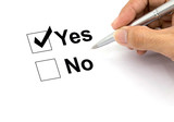 Man hand with pen over document, select Yes.