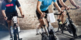 Fototapety sports clothing people riding exercise bikes