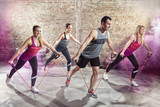 Cheerful people doing workout with stretching band