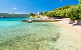 crystal clear adriatic sea on beach on Peljesac peninsula, Dalmatia, Croatia - 122986326