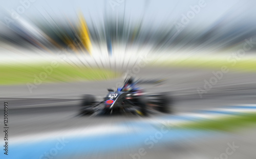 Deurstickers F1 car racing on the road and track with motion blur and Radial blu