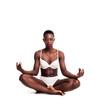 Gorgeous african girl portrait sitting cross-legged while meditating