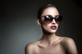 Portrait of beautiful sensual girl in sunglasses
