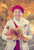 happy mature woman  in autumn