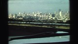 1968: a driver approaches the outskirts of a large metropolitan city. SEATTLE, WASHINGTON