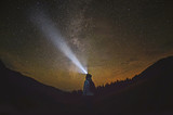 Woman is standing in the forest and pointing the Milky Way ,Carpathian ,Ukraine - Fine Art prints