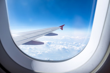 Close up Airplane window with airplane wing ,Traveling concept