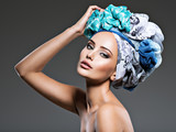 Beautiful woman with hairs wrapped in turban.