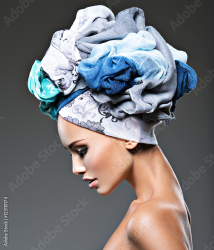Profile portrait of beautiful  girl  in turban.