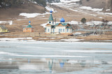 St. Nicholas Church in the village of Big Goloustnoye. View from iced Baikal lake