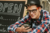 enterprising young man with mobile phone in your small business