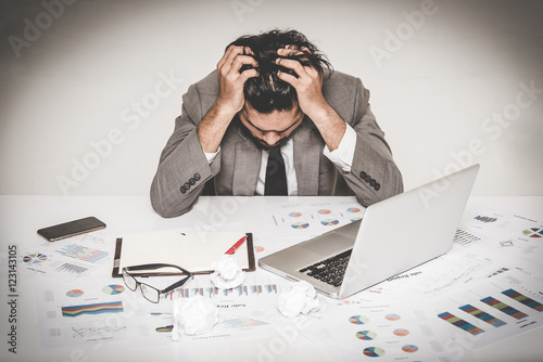 Fridge magnet Portrait of stressed businessman burnout holding his head with both hand at work