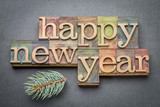 Happy New Year in wood type - 123159722