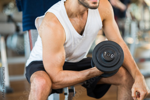 Bodybuilder working out Poster
