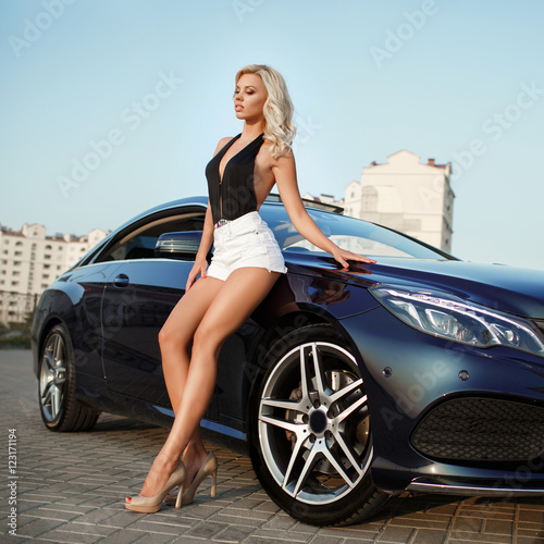 Plakat Sexy blonde woman with sport car.