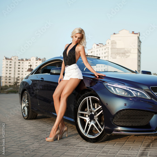 Sexy blonde woman with sport car luxury lifestyle Plakát