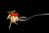 Pasta in black background.