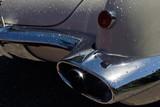 chrome exhaust pipe in a retro car