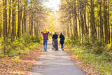 Young Family Outdoors Walking Through Autumn Park - 123198574