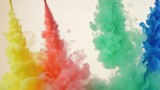 Red, yellow, green and blue ink in water. Bright, vivid, colourful background HD