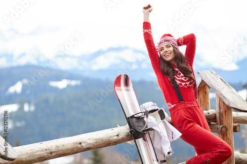 obraz lub plakat winter, leisure, sport and people concept - happy young woman in