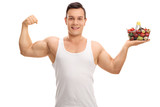 Man flexing his bicep and holding shopping basket