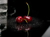 Two juicy fresh wet cherries