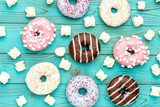 Fototapety Donuts on colorful wooden background