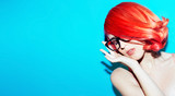 Sensual lady in elegant glasses. Retro style. Red  hair trend