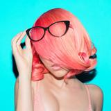 Sensual lady in elegant glasses. Retro style. Pink hair trend