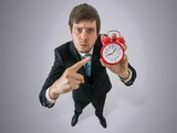 Angry boss is showing clock. Discipline at work concept. View from top.