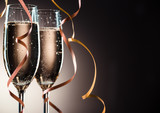 Elegant image closeup of two champagne glasses and decorative ribbons