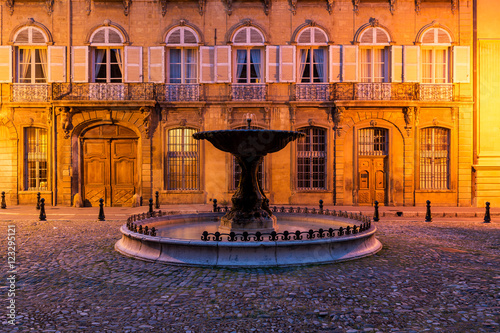A fountain in Aix-en-Provence, France on a spring evening.   Poster