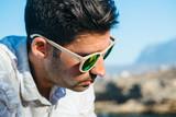 Stylish sad man in sunglasses