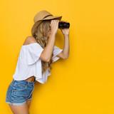 Beautiful Woman Looks Through Binoculars - 123302550
