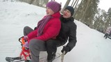 The happy family have fun in winter forest. Slowmotion