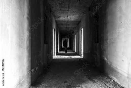 Abandoned building with Ghost walking in wallway