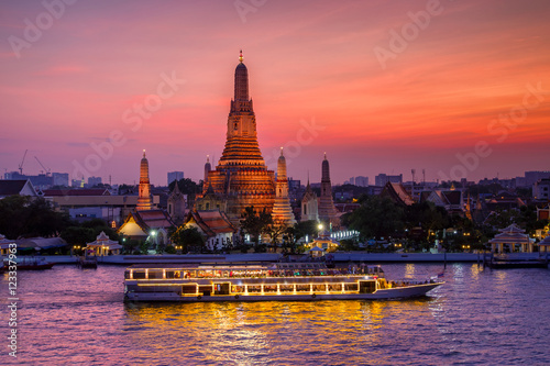 Poster Wat Arun and cruise ship in sunset time, Bangkok city ,Thailand