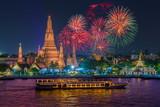 Wat arun and cruise ship in night time under new year celebration, Bangkok city ,Thailand
