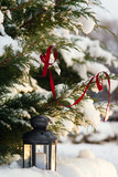 Christmas Lantern On Snow With Fir Branch outdoor closeup