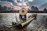 Asian fisherman at sunset
