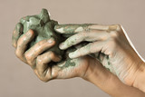 hands with blue clay - 123373559