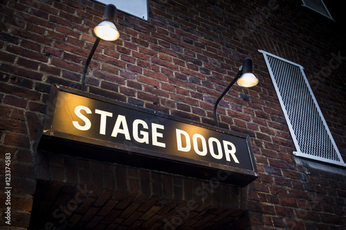 Stage door at London theatre illuminated by spotlights Poster