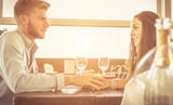 Fototapety Couple in love dating at restaurant